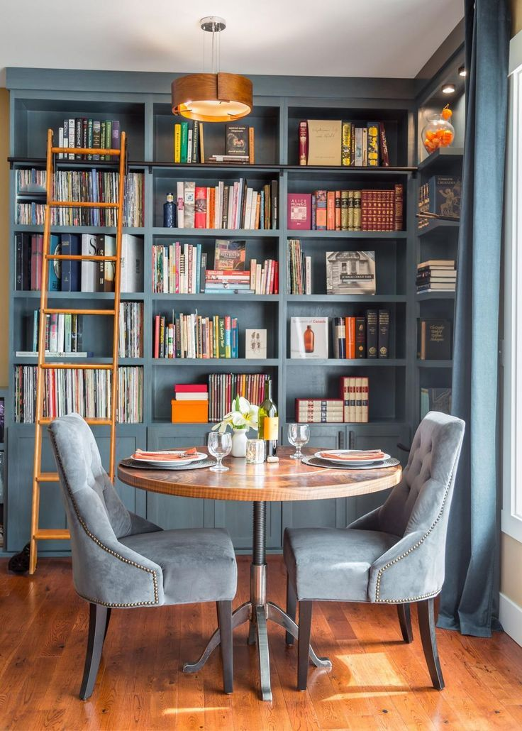 This gorgeous blue home library that once was merely an unused corner in the great room now serves to display an extensive book and music collection.