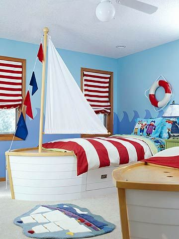 "Pirate Room - Boys will enjoy this pirate-themed room, complete with shiplike beds with their own masts and storage drawers ""below deck."""