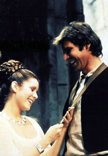 Han Solo and Princess Leia -Star Wars (I bet she just said something snarky.)