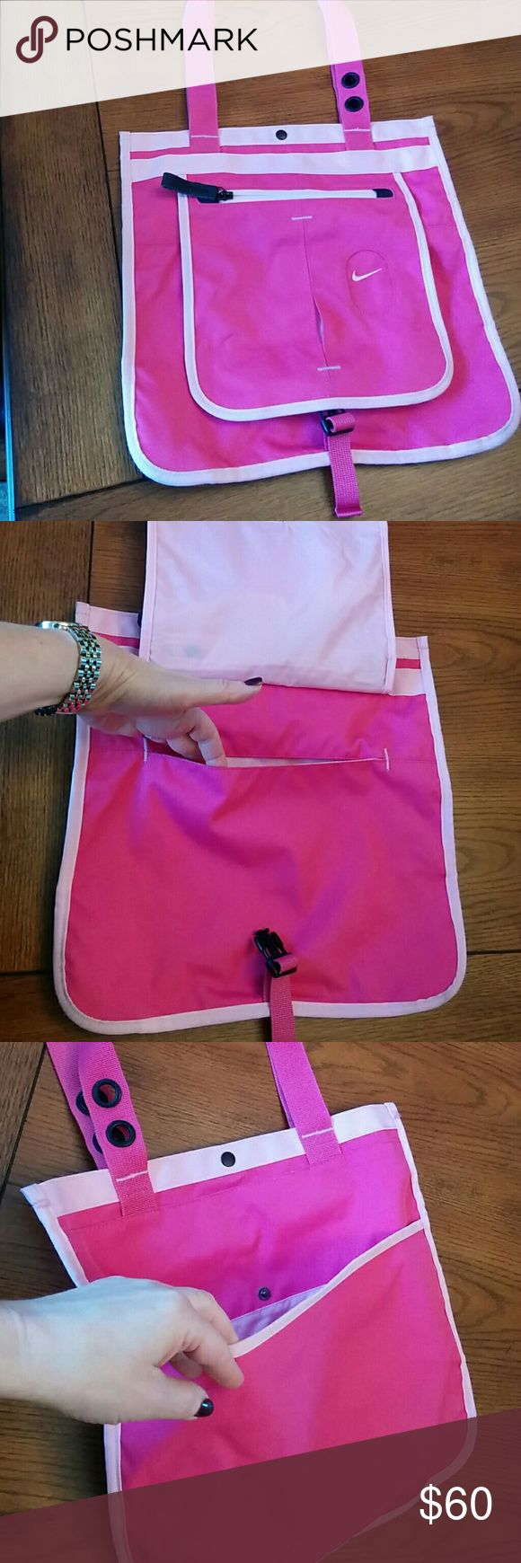 """Nike hot pink  bag Nike hot pink canvas bag has 3 outside pockets, zipper pocket inside. Lightweight, durable polyester canvas.  In very good condition. 13""""x13"""", handle drop 10"""". Detachable purse  4""""x5.5"""". Nike Bags Shoulder Bags"""