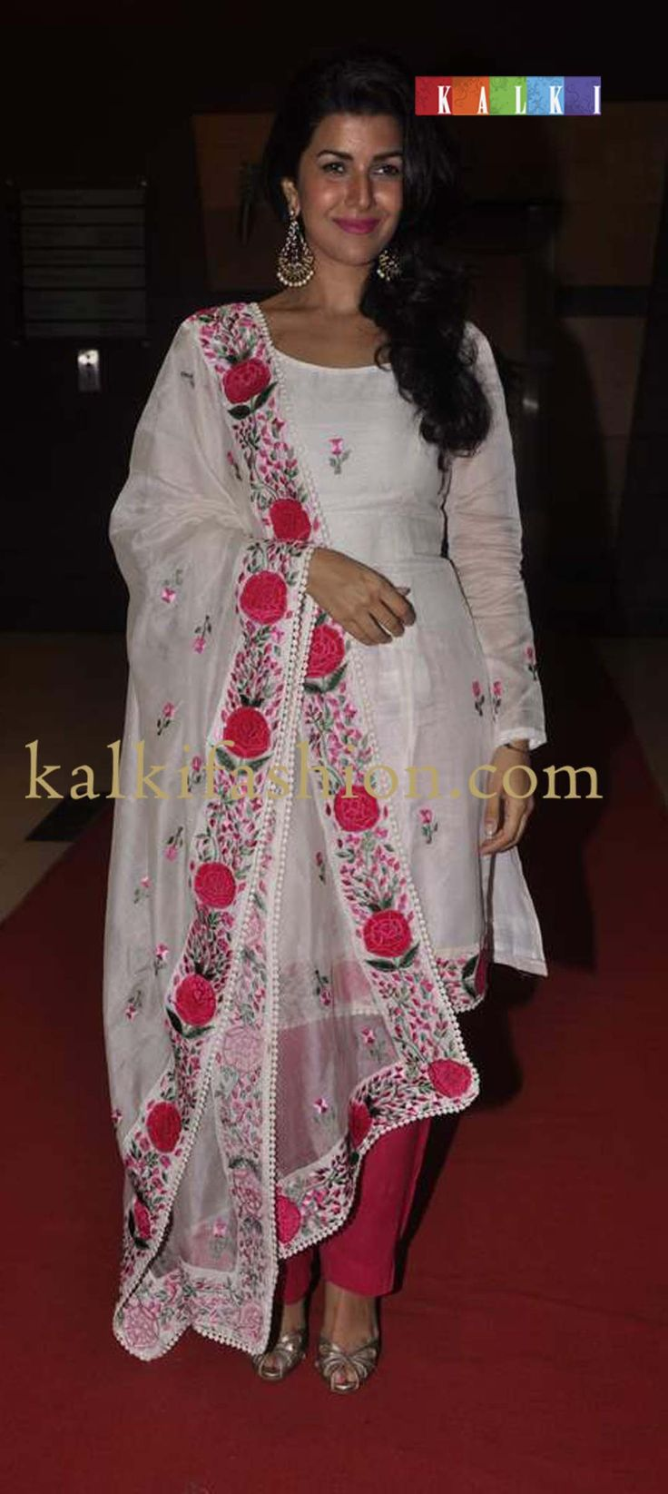 http://www.kalkifashion.com/ Namrit Kaur in an ethnic white salwar kameez with rose motif embroidery at the 4th Jagran film festival .