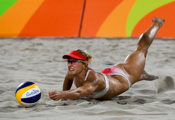 Canada's Heather Bansley dives for a dig during the women's beach volleyball qualifying match between Canada and Germany at the Beach Volley Arena in Rio de Janeiro on August 11, 2016, for the Rio 2016 Olympic Games. / AFP / Yasuyoshi Chiba