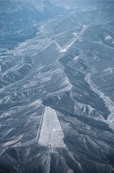 ♥ The Palpa region in the Nazca Desert displays mountains formations  that are ignored from general archeology. The levelled mountain ridge lies like an aircraft carrier in the sparse landscape.