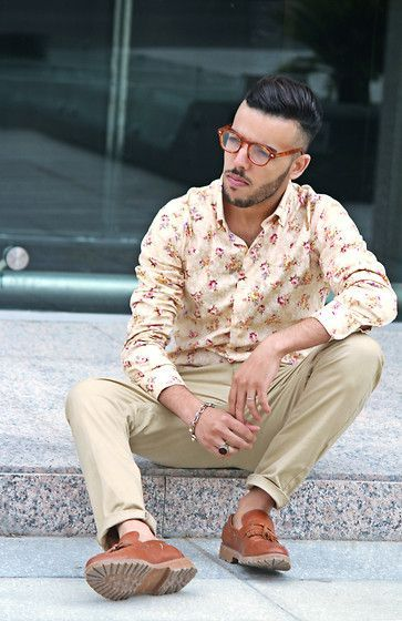 Shop this look on Lookastic:  https://lookastic.com/men/looks/beige-long-sleeve-shirt-beige-chinos-brown-tassel-loafers-silver-bracelet/11917  — Beige Floral Long Sleeve Shirt  — Silver Bracelet  — Beige Chinos  — Brown Leather Tassel Loafers