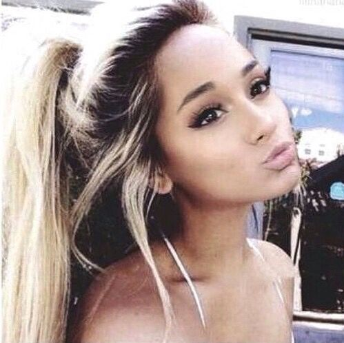 Ariana Grande she ditched the half ponytail and looks stunning. Looks so different!!