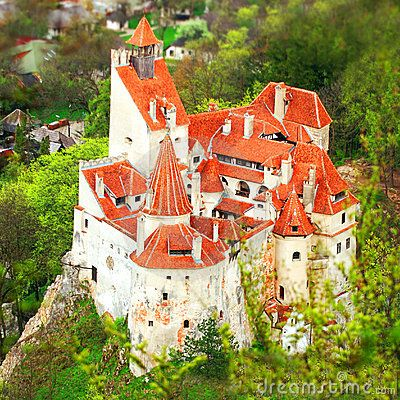 BRAN CASTLE, Transylvania, Central Romania.  Perched high atop a 200-foot-high rock, Bran Castle owes its fame to its imposing towers and turrets as well as to the myth created around Bram Stocker's Dracula.
