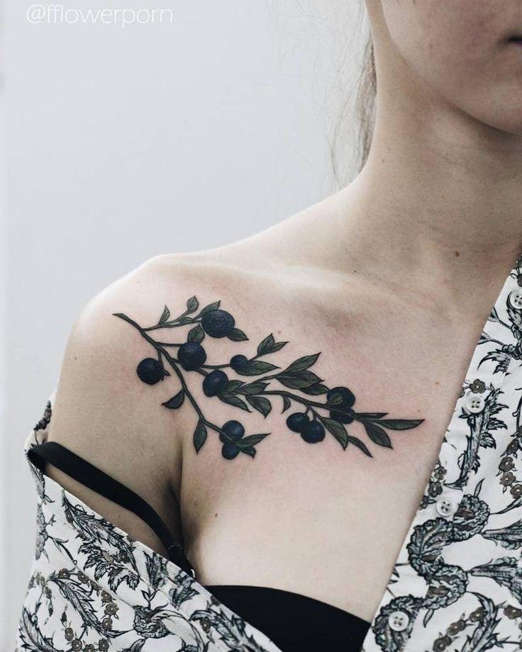 Illustrative blueberry chest tattoo. Tattoo Artist: Olga Nekrasova