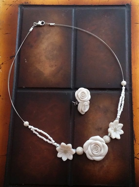 Check out this item in my Etsy shop https://www.etsy.com/listing/238326087/white-pearl-flower-necklace-and-stud
