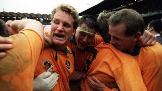 + / 1991 : Michael Lynagh celebrates with his teammates following Australia's World Cup triumph over England