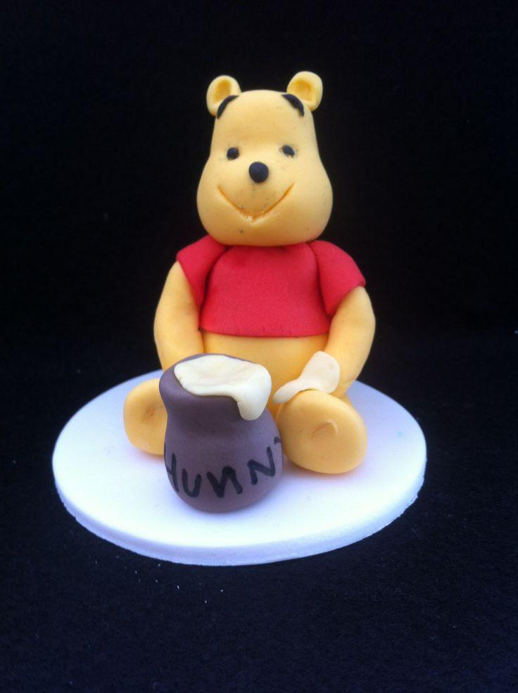 Winnie the Pooh cake topper.