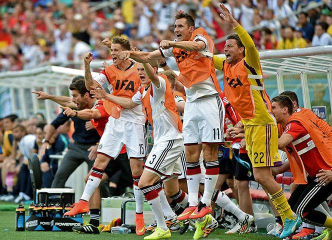 Credit: Patrik Stollarz/AFP/Getty Miroslav Klose and German substitutes celebrate