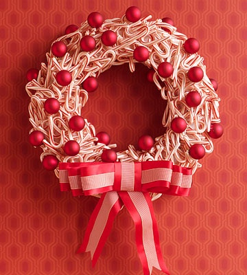 Candy Cane Wreath - I tried this last year and then stored it too near the hot water heater and it ended up in a sticky puddle. Cute and easy idea, though.