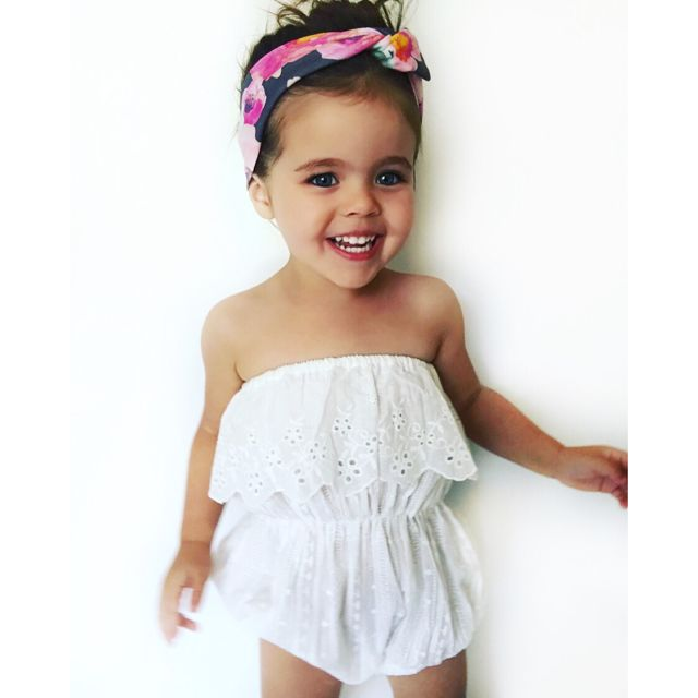 Let your little girl shine in fields of daisies with this pretty white Romper. The BOHEMIAN SHINE romper delivers pretty Scalloped frill edges with embroidered detailing. Snap button closure for easy changing. 100% cotton. Beautifully designed. Pair with gladiator sandals, a flower head garland or rock it with a topknot and your little girl will be ready to shine in the warm summer days!