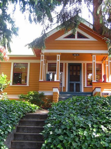 Love the slate blue porch and white trim/details on this Seattle home.