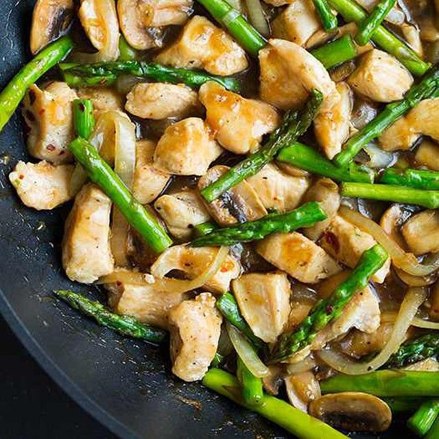 Ginger Chicken Stir-Fry with Asparagus  Made by @cookingclassy Follow her @cookingclassy  Yield: About 4 servings  Ingredients 1 1/4 lbs boneless skinless chicken breast, diced into 1-inch pieces 4 1/2 tsp canola oil, divided 1 lb asparagus, end portions trimmed and remainder diced into 1 1/2-inch pieces 1 small yellow onion, sliced into thin strips 8 oz button mushrooms, sliced* 1/4 tsp red pepper flakes, then more for garnish if desired 1 Tbsp peeled and finely grated fresh ginger 4 cloves…