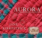 An American Experience in Quilt, Community and Craft.  Beautiful Book, seen Jane at Aurora getting ready for book signing.