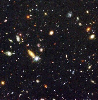 Hubble Deep Field Image Unveils Myriad Galaxies Back to the Beginning of Time.  About 1,500 galaxies are visible in this deep view of the universe, taken by allowing the Hubble Space Telescope to stare at the same tiny patch of sky for 10 consecutive days in 1995. The image covers an area of sky only about width of a dime viewed from 75 feet away.