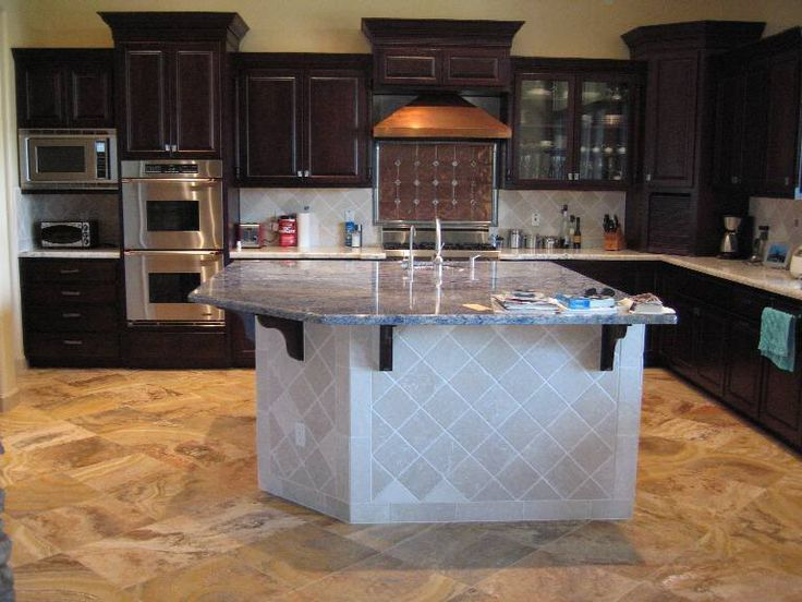 good Tile On Kitchen Island #9: Staggered cabinets. Varying height and depth with a purpose. dark wood kitchen  tiled island