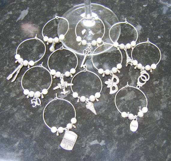 If youre having a 50 Shades party, these will make great gifts.   Each charm has 2 grey pearls, 2 white pearls, 2 teardrops and a charm, which will