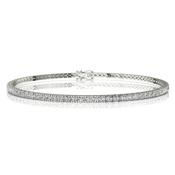 """Bracelet rivière diamant 2 carats or blanc Cobee  Cobee, charmante rivière diamant de 2 carats.  Fabriquée dans nos ateliers, et montée entièrement à la main, ce bracelet diamant peut être réalisé en or palladié, blanc, jaune ou rose 18 carats. Avec son système de double fermeture, il est parfaitement sécurisé. Chaque diamant est serti de 4 griffes, avec une monture révolutionnaire """"touche-touche"""" qui assure une ligne visuelle de diamants éclatante.  Ce bracelet rivière diamant est constitué…"""