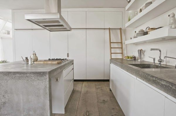 stylish white and concrete kitchen by paul van de kooi