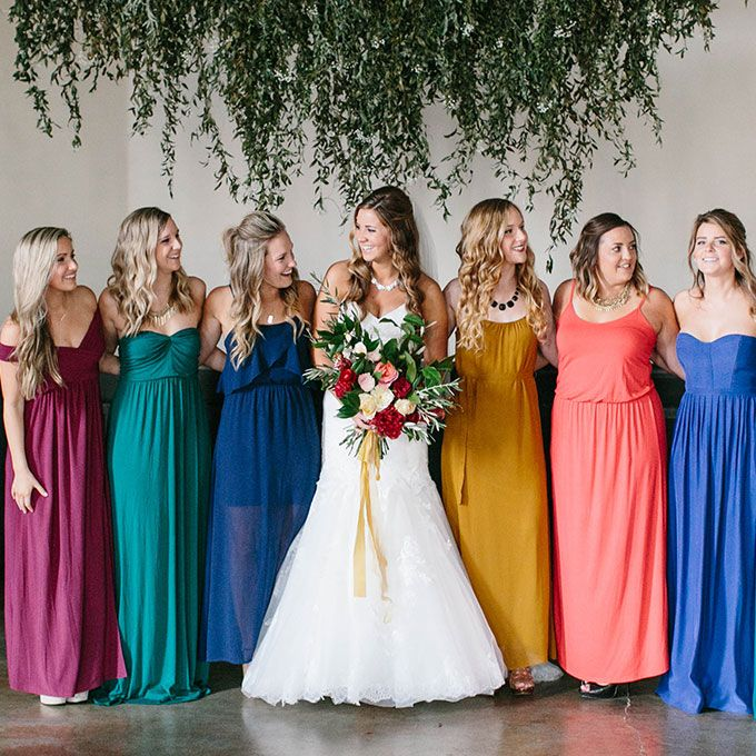 Brides.com: . Jewel tones make for a showstopping bridal party.