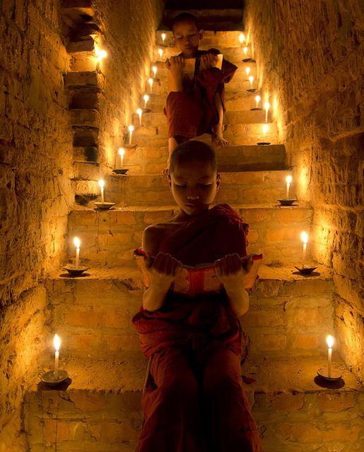 """If you want to become full, let yourself BE empty.""    ~  Lao Tzu   Photographer:  Marty Windle  * Novice monks studying on illuminated staircase - Bagan  ॐ lis"