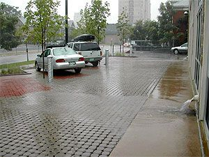 Porous pavement in parking lots reduce impervious areas, recharge ground water, improves water quality and eliminates the need for detention basins.