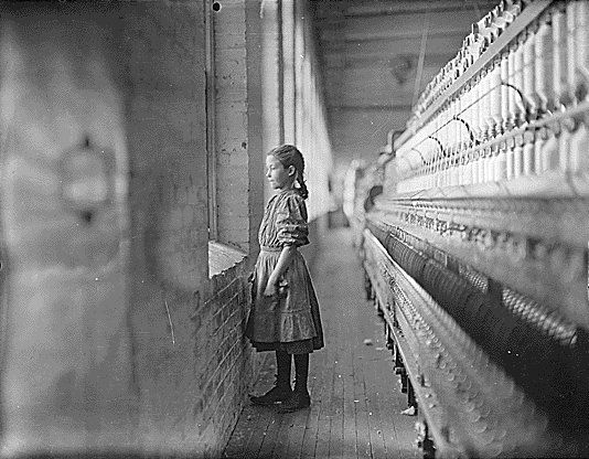"""A moments glimpse of the outer world.  Said she was 10 years old. Been working over a year."" North Carolina, Lewis Hine, 1908"