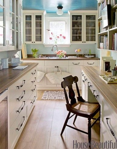 Cool small space kitchen- note light fixture, countertops and painted ceiling!