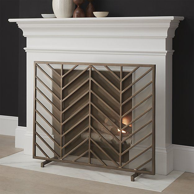 Chevron Brass Fireplace Screen, clean and classic fireplace mantel and navy painted walls