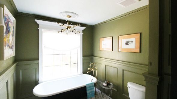 OMG, this bathroom!!! I love the crown molding and the paneling/ chair railing, it adds such a classy expensive look!
