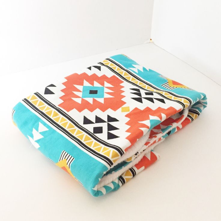 A personal favourite from my Etsy shop https://www.etsy.com/listing/489968307/tribal-baby-blanket-soft-baby-blanket