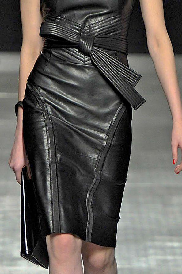 Black leather dress, belted.