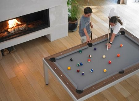 A modern pool table that transforms into a dinner table. I really want this