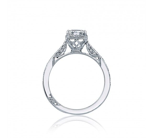 A+classic+look+with+modern+flair,+a+crown+of+diamonds+surrounds+an+emerald-cut+center+stone,+adding+depth+and+dimension.