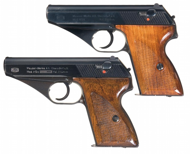 "Two Mauser HSc 7.65mm pistols. The lower example is called the ""three-line"" variation due to the markings rolled onto the left of the slide. Both were militarily accepted as evidenced by the WaA135 acceptance mark at the lower end of the triggerguard."