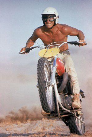 This shot of Steve McQueen out in the California desert on his Husqvarna dirt bike kind of shows why people ride dirt bikes in the desert. Because it is an amazing challenge and an amazing feeling to overcome it... (BTW: I wear a shirt usually . . . and gloves)