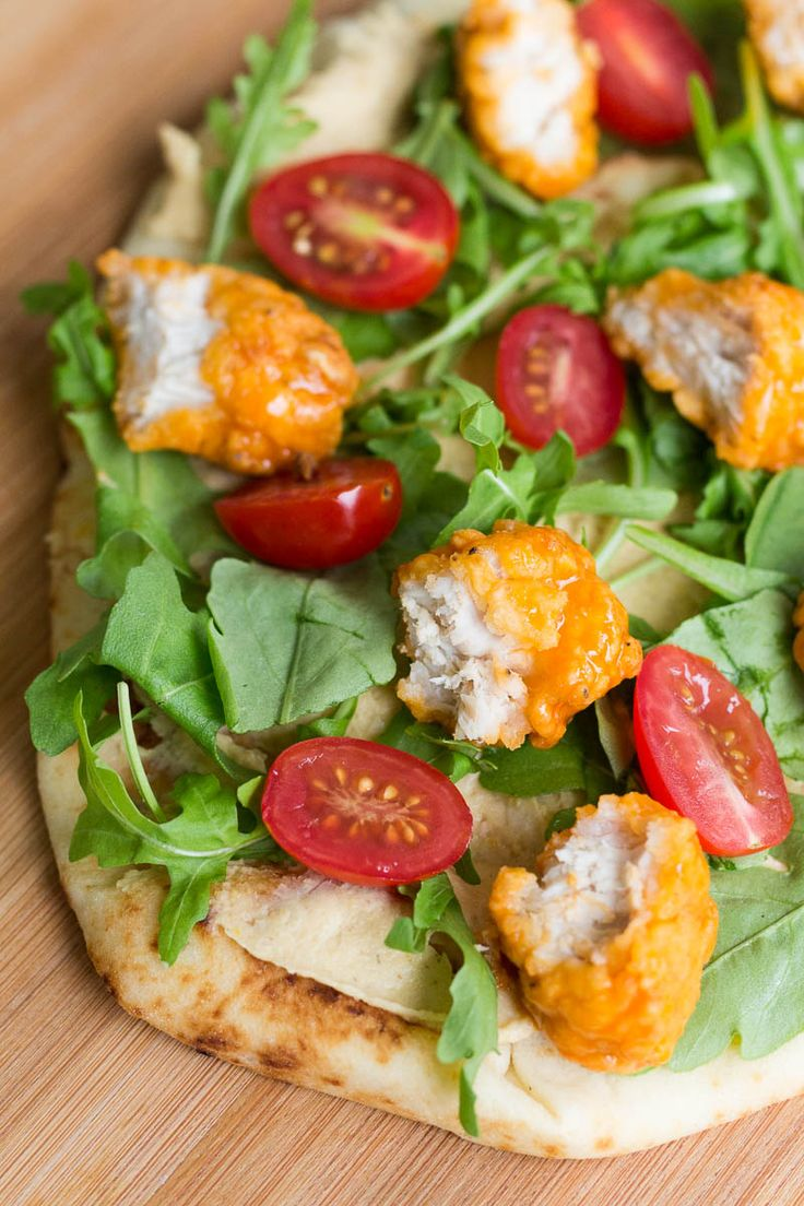 This buffalo chicken sandwich on flatbread is simple, flavorful, and works great as a quick appetizer or main course. It's easy and delicious! Sponsored by Walmart.