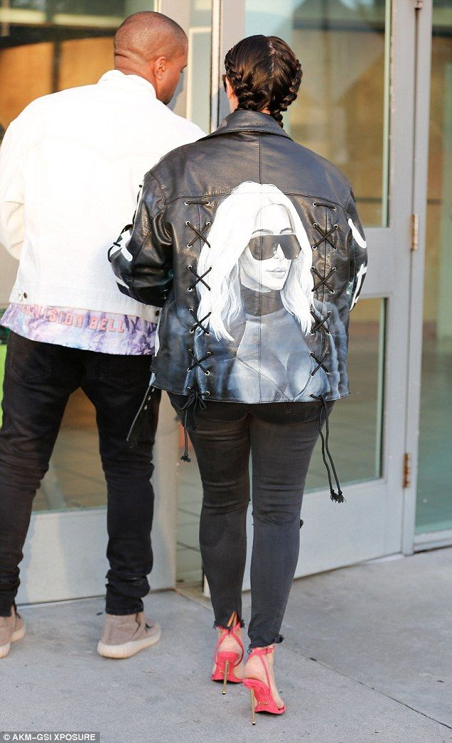 Kim Kardashian wears custom leather jacket with her face on it with Kanye West | Daily Mail Online