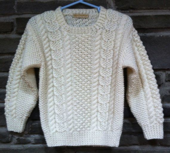 Design by Melinda Goodfellow of Yankee Knitter Designs http://www.yankeeknitterdesigns.com/  Childs Irish Knit Aran Sweater in traditional