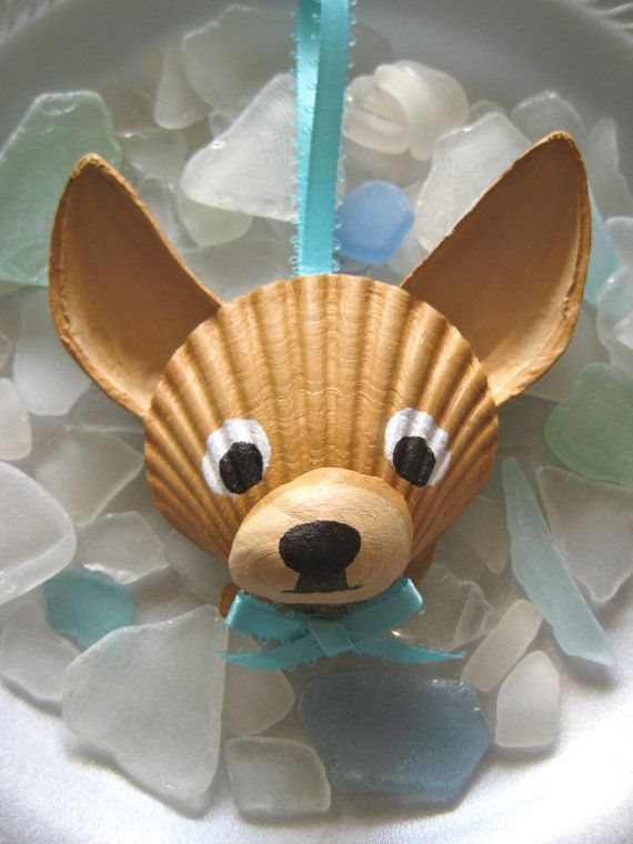 This adorable, carefully hand painted Chihuahua is made entirely of seashells, most of which I collected myself from my favorite Cape Cod beach. The face is a scallop shell, nose a slipper shell and ears are made of mussel shells. Perfect for dog and beach lovers!    I use acrylic paint then finish it with an acrylic sealer for protection.    Thanks for having a look!    © Lori Muir, 2012