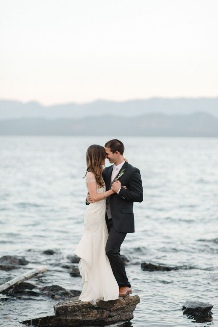Such a cool Bride & Groom Portrait Shot!  Photography: RebeccaHollis.com -- Wedding on #SMP here: http://www.StyleMePretty.com/northwest-weddings/2014/03/14/classic-flathead-lake-montana-wedding