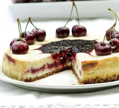 Fresh Cherry swirl cheesecake with shortbread cookie crust.