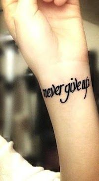 Never give up writing tattoo on wrist