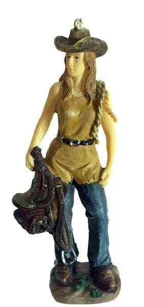 Cowgirl with Saddle Christmas Ornament has a flat base. She can also work in doll house projects or tuck her into your Nativity set for a bit of western.