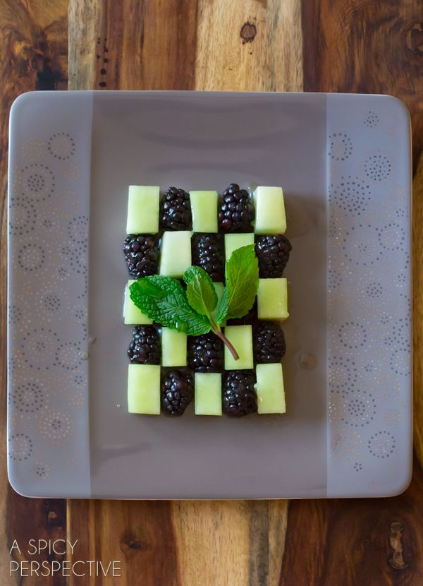 Easy Blackberry Honeydew Salad with Honey Lime Syrup by aspicyperspective: Just arrange the fruit in a pretty way on a plate. Sprinkle with fresh mint leaves. And drizzle honey lime syrup over the top. Done and yum. #Salad #Melon #Blackberry #Mint #Honey #LIme #Healthy #Light