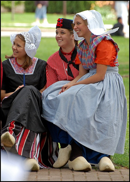 Smile for me!! Girls in Dutch dress wait for their turn to dance during the Holland Michigan Tulip Time festival.