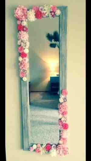 DIY...Embellished wall mirror...glue gun & some dollar store fake flowers..easy & pretty