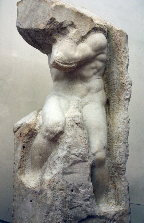 """The Atlas Slave -- """"All the unfinished statues at the Accademia reveal Michelangelo's approach and concept of carving. Michelangelo believed the sculptor was a tool of God, not creating but simply revealing the powerful figures already contained in the marble."""" #italy #michelangelo"""
